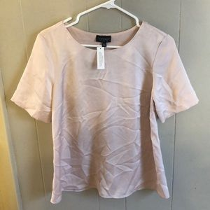NWT Topshop satiny nude blouse. Faux wrap back.